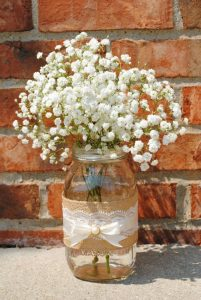 burlap wrapped mason jar with babys breath