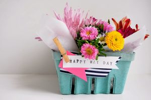 berry basket filled with flowers