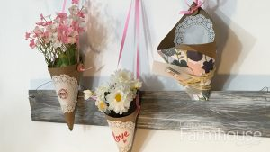 three paper cones with flowers