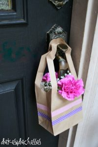 paper bag with flowers hanging on door