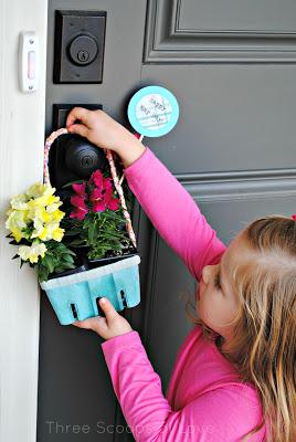 girl hanging basket on door