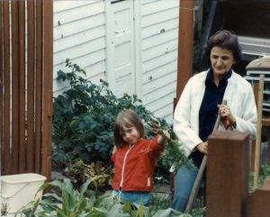grandma and young girl in garden